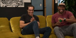 two men in addiction treatment laughing
