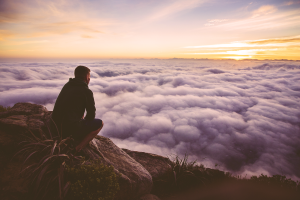 man above the clouds after a climb | drug recovery